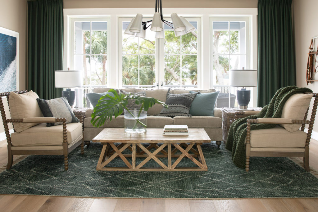 A living room filled with seating furniture and a large window from the hgtv dream home 2020